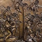 Bajorrelieve donde se ve a los demonios infestando un nogal que se alza sobre los huesos de Nerón.