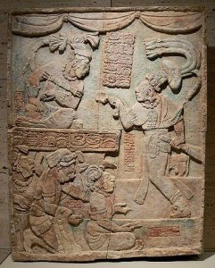 Escultura del período Clásico, que muestra el sajal Aj Chak Maax presentando cautivos al gobernante Itzamnaaj B'alam III de Yaxchilán.