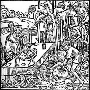 Vlad III desayunando ante unos empalados en un grabado alemán. En sus inhumanas orgías de sangre, la altitud de la estaca indicaba el rango que la víctima había tenido en vida.